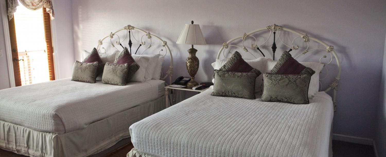 Orchid Retreat Double Queen Suite Beds