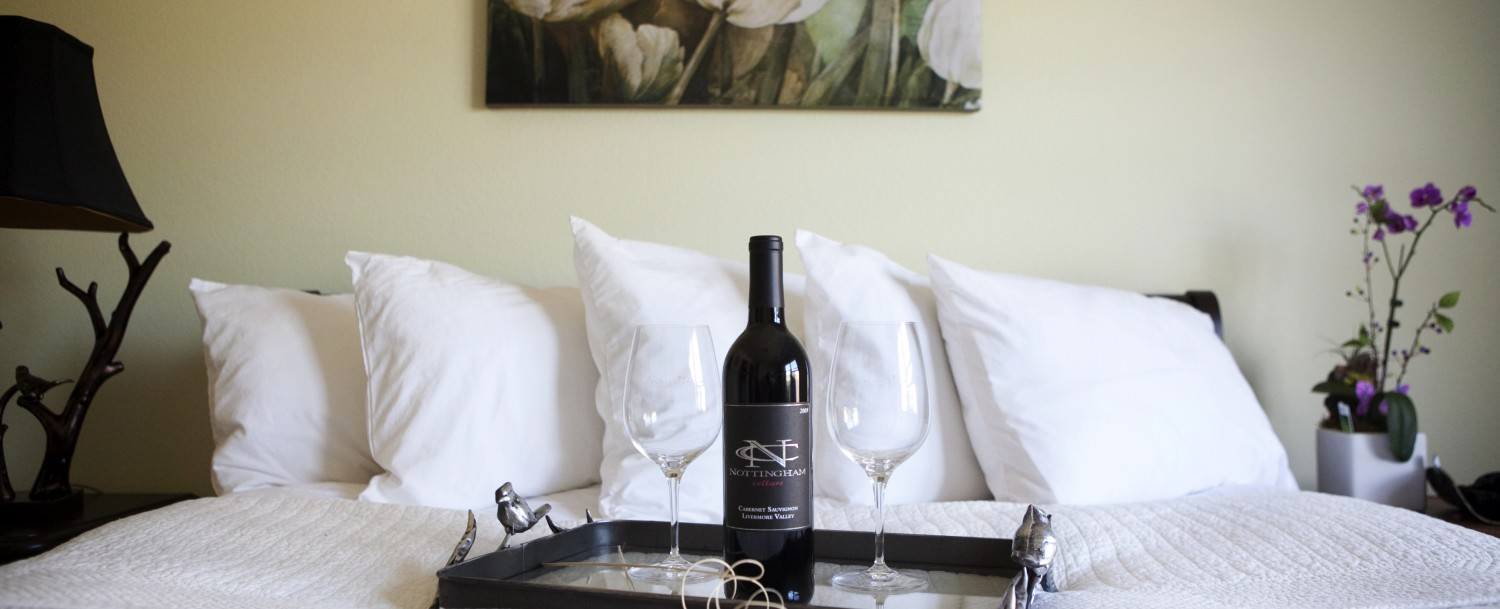 Bed with Wine and Glasses