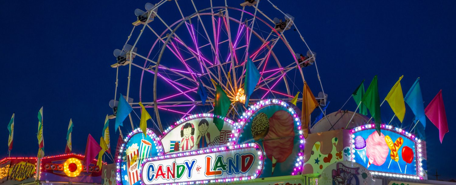a ferris wheel and candy stand at the alameda county fair