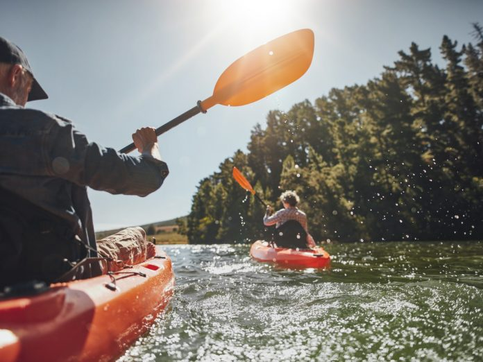 People kayaking at Shadow Cliffs Regional Recreation Area.