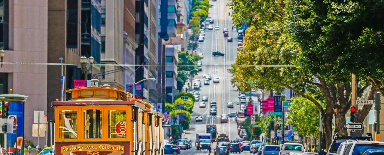 Trolley driving on winding street in San Francisco.