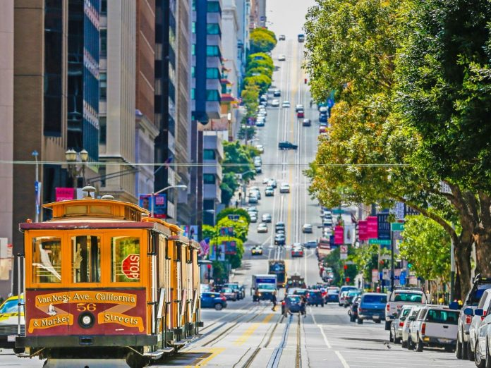 Trolley driving on winding street in San Francisco.