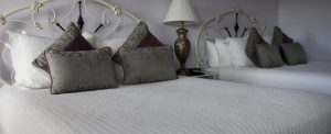 View of two queen-size beds in the Grand Champion room at the Purple Orchid.